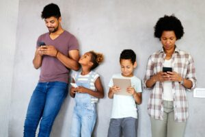 Family sharing there privacy data by using digital devices, phones, tablets